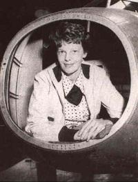 famous fliers [&] amelia earhart and capt. frank hawks [&] amelia earhart inspects flying laboratory by amelia earhart